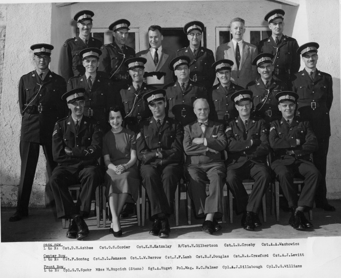 Group photograph of RCMP Richmond Detachment personnel, including Police Magistrate R.C. Palmer, in the 1950s. City of Richmond Archives Photograph 2010 37 1
