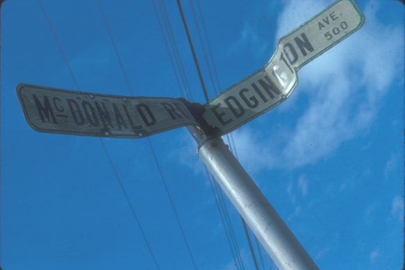 Street sign at corner in the old Cora Brown subdivision. McDonald Road (still in existence) was named after pioneer farming family on Sea Island. Edgington Avenue (disappeared with the federal expropriation of Cora Brown for airport expansion)  was named after Private Erine Edgington, a former Richmond High student, who was killed in action in Italy during World War II. City of Richmond Archives Photograph 1997 42 1 483